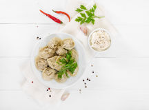 Boiled meat dumplings in white plate. Top view. stock photo