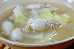 Boiled minced pork stuffed squid with Chinese cabbage hot soup in bowl Stock Photo