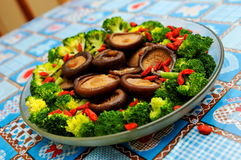 Boiled mushroom and broccoli Stock Photography