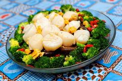 Boiled mushroom and broccoli topped with scallops Stock Photo