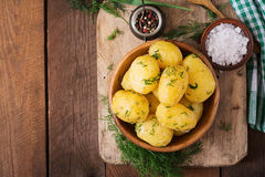 Boiled new potatoes seasoned with dill and butter. Stock Photo