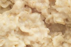 Boiled oat porridge, macro photography, prepared royalty free stock photography