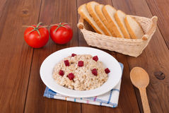 Boiled oatmeal in a plate Stock Image