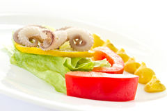 Boiled octopus with lemon slice Royalty Free Stock Photos