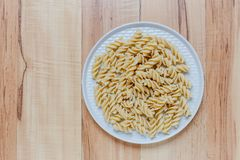 Boiled pasta in the form of spirals stock photo