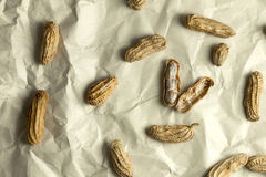 Boiled peanuts arrange on crumpled paper. The boiled peanuts arrange on crumpled paper Royalty Free Stock Photo