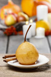 Boiled pear with cinnamon Royalty Free Stock Images