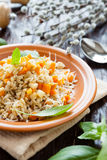 Boiled pearl barley and vegetables Royalty Free Stock Images