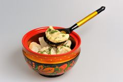 Boiled pelmeni in khokhloma painted russian wooden bowl with spoon Royalty Free Stock Photos