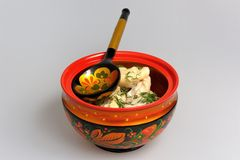 Boiled pelmeni in khokhloma painted russian wooden bowl with spoon Stock Images