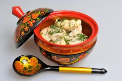 Boiled pelmeni in khokhloma painted russian wooden dishes with spoon Stock Images