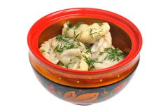 Boiled pelmeni in traditional painted russian wood Stock Photos