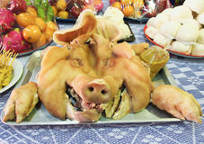 Boiled pig head for sacrifice and vow Stock Image