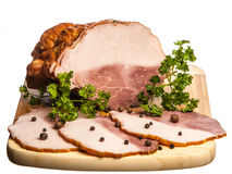 The boiled pork decorated by pepper and a parsley Royalty Free Stock Image
