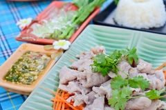 Boiled pork with lime ,garlic and chili sauce (pork with lime ) Stock Photo