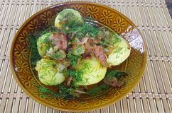 Boiled potato with fried bacon Stock Photography