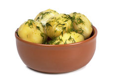 Boiled potatoes. With butter in a brown ceramic bowl image isolated on a white background Stock Image