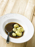 Boiled potatoes in brown sauce Royalty Free Stock Photography