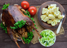 Boiled potatoes in a clay bowl, baked goose and cabbage salad. Royalty Free Stock Photos