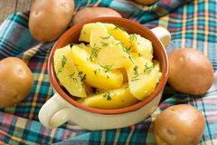 Boiled potatoes with dill and butter Stock Image