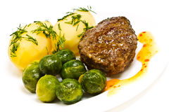 Boiled potatoes with dill, cutlet Royalty Free Stock Photos