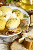 Boiled potatoes with dried fish. Boiled potatoes with dried fish, Russian cuisine Royalty Free Stock Photography