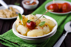 Boiled potatoes with herbs and pickled tomatoes Stock Photos