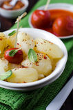 Boiled potatoes with herbs and pickled tomatoes Royalty Free Stock Photos