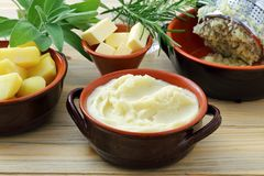 Mashed potatoes on rustic table background Stock Photos
