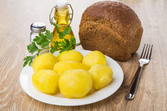 Boiled potatoes in plate, parsley, vegetable oil, salt, bread Stock Photography