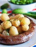 Boiled potatoes with Ukrainian sausage Royalty Free Stock Photos
