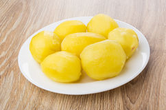 Boiled potatoes in white plate on table Royalty Free Stock Images