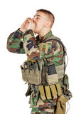 Portrait soldier or private military contractor shouting with hands cupped. Stock Image