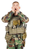 Portrait soldier or private military contractor shouting with hands cupped.  Stock Photos