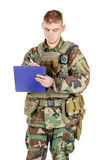 Young soldier standing with folder for documents  Royalty Free Stock Image