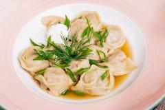 Boiled prepared homemade russian dumplings or pelmeni with beef Royalty Free Stock Photo