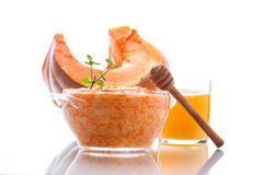 Boiled pumpkin with rice and honey Stock Image