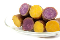Boiled purple  and yellow yams boiled in plate on white backgrou Royalty Free Stock Image