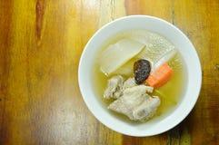 Boiled radish with pork bone soup on bowl. Boiled radish with pork bone soup on the bowl Stock Photos