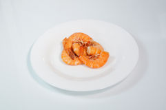 Boiled red prawns on a white plate Royalty Free Stock Images