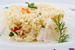 Boiled rice. With greens and vegetables Stock Photo