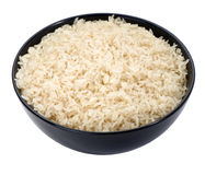 Boiled rice in a black bowl close-up isolated Stock Images