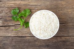 Boiled rice in a bowl on wooden rustic table.  royalty free stock image