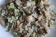 Boiled rice with chicken meat and herbs stock photos