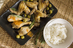 Boiled rice and chicken wings and legs Stock Photo