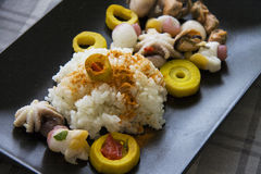 Boiled rice with curry and molluscs. Seafood molluscs, marinated bamboo and rice in traditional korean kitchen recipe Stock Photography