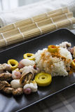 Boiled rice with curry and molluscs. Seafood molluscs, marinated bamboo and rice in traditional korean kitchen recipe Royalty Free Stock Photography
