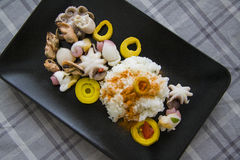 Boiled rice with curry and molluscs Royalty Free Stock Image