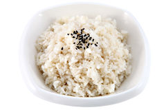 Boiled rice in a deep plate, isolated on white. Stock Photos