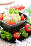 Boiled rice with fresh cherry tomatoes Royalty Free Stock Photo